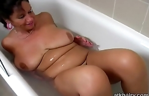 Big tit British hairy MILF Kimberly plays with the brush self in the bathtub