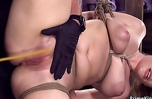 Hot ass babe less hogtie whipped with the addition of caned
