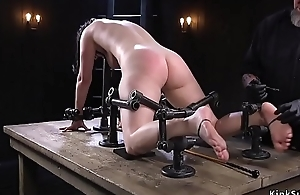 Busty babe in arms in metal equipment feet distressful